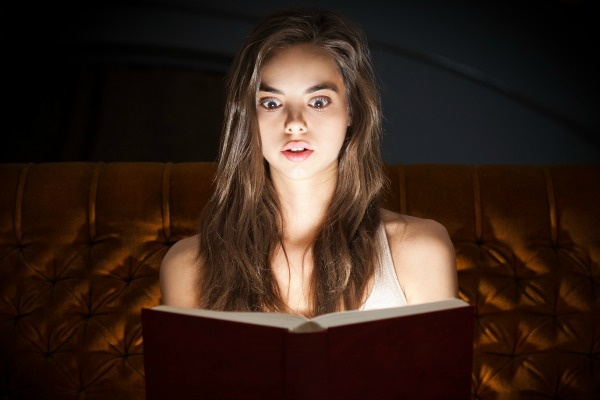 Shocked Woman Reading Book
