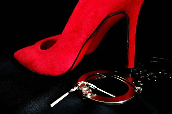 red shoe with handcuffs